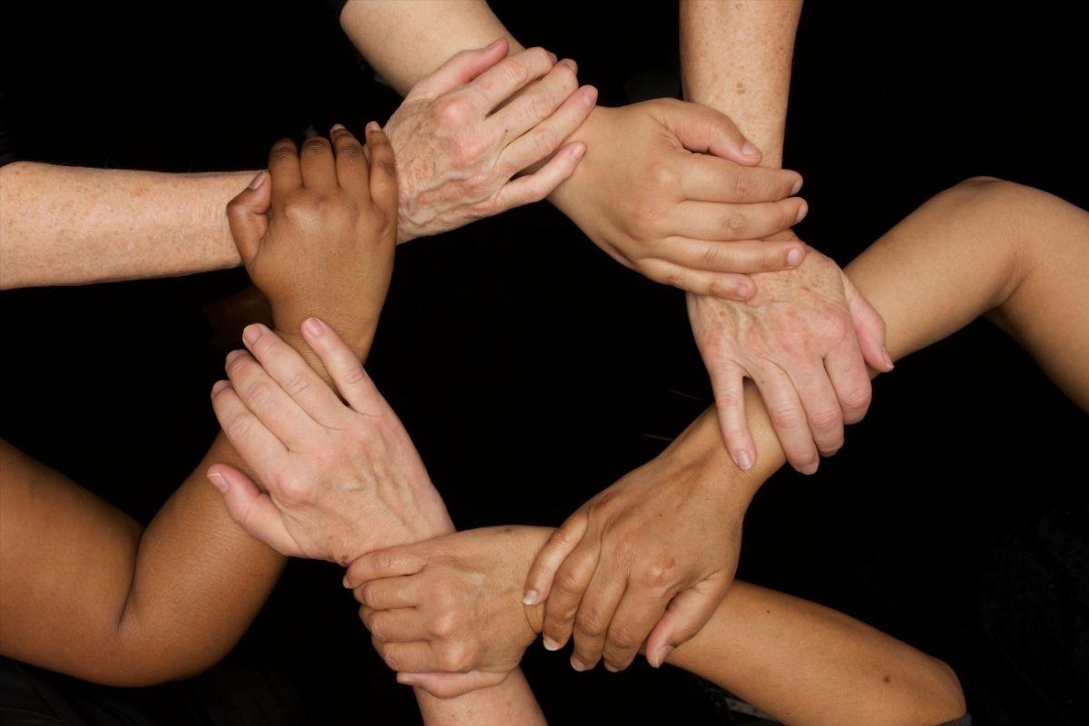 Women joint hands